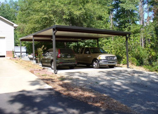 Flat bronze freestanding carport near Greer, SC.